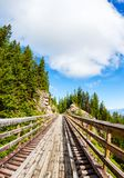 Historic Trestle Bridge at Myra Canyon in Kelowna, Canada. Originally one of 19 wooden railway trestle bridges built in the early 1900s in Myra Canyon, Kelowna Stock Image