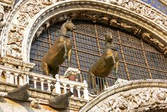 Famous bronze horse statues on top of St Mark`s Cathedral in Venice, Italy royalty free stock image
