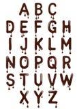 Origineel modieus Latijns die alfabet van gesmolten chocolade wordt gemaakt royalty-vrije stock foto's