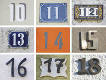 Originele huisnummers 10 tot 18 Stock Foto