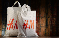 Originele plastic het winkelen van H&M zakken Stock Foto's