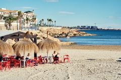 People sitting at the beach cafe in the Cabo Roig. Spain stock photography