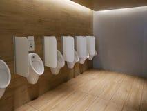 Orinales limpios públicos del lavabo del retrete de los hombres modernos imágenes de archivo libres de regalías