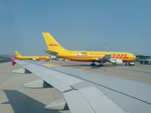 DHL Deutsche post aircrafts parked at the airport royalty free stock photography