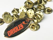 Baltimore Orioles Lapel Pin and Pin backs. Orioles lapel pin and a bunch of pin backs to protect the wearer of the pin Stock Image