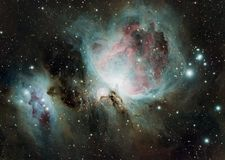 The Orion Nebula also known as Messier 42, M42, or NGC 1976. The Orion Nebula is a diffuse nebula situated in the Milky Way, being south of Orion`s Belt in the stock image
