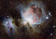 The Orion Nebula also known as Messier 42, M42, or NGC 1976. The Orion Nebula is a diffuse nebula situated in the Milky Way, being south of Orion`s Belt in the royalty free stock photo