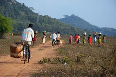 Orissa's tribal people return from weekly market Royalty Free Stock Image