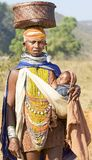 Orissan tribal woman carryng a baby. Orissa has 62 distinct tribal groups, making it the largest collection of tribal people in a single state in the country Stock Photo