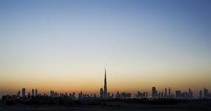 Orizzonte della Doubai al tramonto Fotografie Stock Libere da Diritti