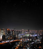 Orizzonte di notte di Osaka con le stelle Fotografia Stock