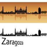 Orizzonte di Saragozza nel fondo arancio Immagini Stock