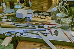 Ork bench in a glasses shop. The optician here not only tests you eyes but he then handcrafts your eyewear. FRANCE, STRASBOURG - JUNE, 2015: Work bench in a royalty free stock image