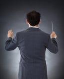 Orkiestra dyrygent z batutą fotografia stock