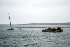 Orkney island Scotland scapa bay sunken rusty ship wreck Royalty Free Stock Image