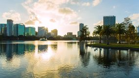 Orlando downtown, the Eola lake and park. Sunset over the Eola lake, Eola Park, Orlando, Florida USA stock video footage