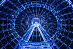 Orlando Eye, one of the longest wheel cabinets in the world. The Orlando Eye, one of the longest wheeled cabinets in the world, blinking blue with its blue royalty free stock photos