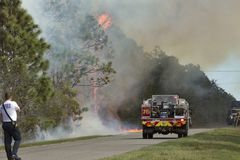 Fire Watch. Orlando, FL. 3 March 2018 - Orange County Florida Fire Rescue Department works to contain and then put out a fire in the Wedgefield subdivision. The Stock Photo