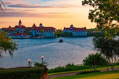 Beautiful view of Grand Floridian Resort & Spa and taxi boat on blue lake at Walt Disney World  area  2. Orlando, Florida. April 23, 2019. Beautiful view of stock photo
