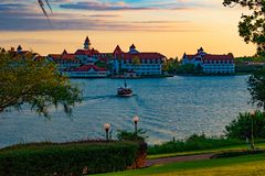 Beautiful view of Grand Floridian Resort & Spa and taxi boat on blue lake at Walt Disney World  area  1. Orlando, Florida. April 23, 2019. Beautiful view of stock photo