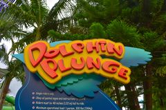Colorful Dolphing Plunge sign at Aquatica water park . Orlando, Florida. April 07, 2019. Colorful Dolphing Plunge sign at Aquatica water park stock images