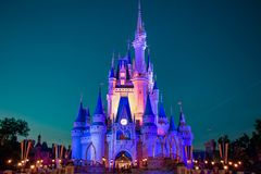 Panoramic view of illuminated Cinderella`s Castle on blue night background in Magic Kingdom at Walt Disney World 2 royalty free stock photo