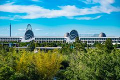 Panoramic view of Orlando Convention Center and green forest background on lightblue sky cloudy background at Seaworld in Internat royalty free stock photo