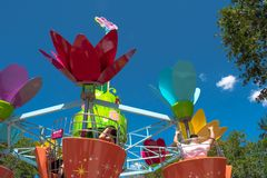 Parents and kids enjoying  colorful flower pots aboard Abby's Flower Tower on lightblue sky background at Seaworld in Internatio. Orlando, Florida. April stock image