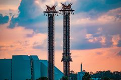 People enjoying Doctor Doom's Fearfal on colorful sunset bakcground at Universal Studios area. Orlando, Florida. April 18, 2019. People enjoying Doctor royalty free stock images