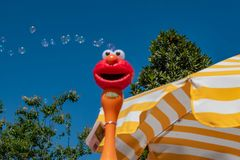 Top view of umbrella and bubbles coming out of Elmo toy at Seaworld in International Drive area 2. Orlando, Florida. April 20, 2019. Top view of umbrella and stock images