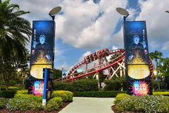 Blue Man Group Main Entrance and red rollercoaster with fanny riders. royalty free stock photos