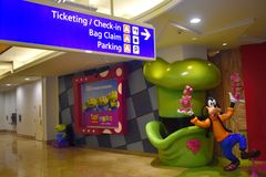 Ticketing and Check in information sign at the airport and Goofy. stock images