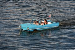 Water Taxi , Blue Vintage Car, Funny People. Orlando, Florida August 24, 2018 Water Taxi Blue Vintage Car, Funny People royalty free stock photography