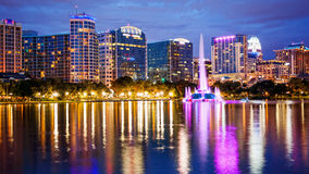Orlando, Florida City Skyline on Lake Eola at Night logos blurr. Orlando, Florida city skyline and water fountain at night in Lake Eola Park, building logos Stock Images