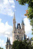 ORLANDO, FLORIDA - DECEMBER 15:Disney castle framed amidst trees, clouds and sky Royalty Free Stock Image