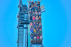 People enjoy thrills for ride of the Mako roller coaster in amusement park at Seaworld in International Drive area 4. Orlando, Florida. December 26, 2018. People royalty free stock photography