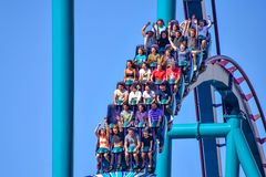 People enjoy thrills for ride of the Mako roller coaster in amusement park at Seaworld in International Drive area 22. Orlando, Florida. December 26, 2018 royalty free stock image