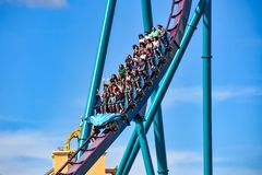 People enjoy thrills for ride of the Mako roller coaster in amusement park at Seaworld in International Drive area 3. Orlando, Florida. December 26, 2018. People royalty free stock photography