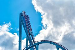 People enjoy thrills for ride of the Mako roller coaster in amusement park at Seaworld in International Drive area 17. Orlando, Florida. December 26, 2018 stock photo