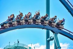 People enjoy thrills for ride of the Mako roller coaster in amusement park at Seaworld in International Drive area 15. Orlando, Florida. December 26, 2018 royalty free stock photos