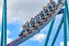 People enjoy thrills for ride of the Mako roller coaster in amusement park at Seaworld in International Drive area 11. Orlando, Florida. December 26, 2018 stock photography