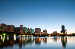 Orlando Florida Downtown Skyline at Night. Orlando Florida city skyline at night reflected on Lake Eola Royalty Free Stock Photography