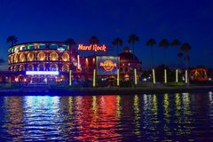 Panoramic view of Hard Rock Cafe and red rollercoaster on blue night background in Citywalk at Universal Studios area. stock image