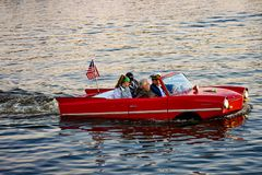 People enjoying ride in red amphibious car at Lake Buena Vista area 2. Orlando, Florida; January 11, 2019 People enjoying ride in red amphibious car at Lake royalty free stock photo
