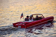 People enjoying ride in red amphibious car at Lake Buena Vista area 3. Orlando, Florida; January 11, 2019 People enjoying ride in red amphibious car at Lake stock images