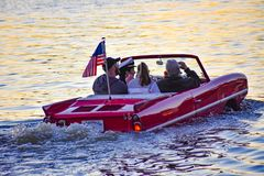 People enjoying ride in red amphibious car at Lake Buena Vista area 4. Orlando, Florida; January 11, 2019 People enjoying ride in red amphibious car at Lake stock photos