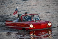 People enjoying ride in red amphibious car at Lake Buena Vista area 1. Orlando, Florida; January 11, 2019 People enjoying ride in red amphibious car at Lake royalty free stock images