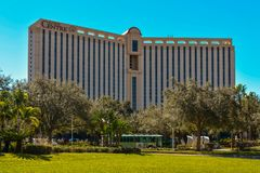 Rosen Centre Hotel and green trolley at International Drive area. royalty free stock photo