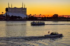 Water taxi, amphibious car on silhoutte of Cirque du Soleil background at Lake Buena Vista area. Orlando, Florida. January 11, 2019 Water taxi, amphibious car royalty free stock image