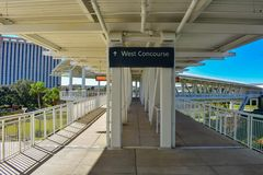West Concourse sign an partial view of bridge at International Drive area. Orlando, Florida. January 12, 2019 West Concourse sign an partial view of bridge at stock image